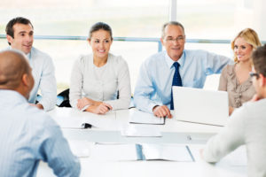 A large cheerful group of successful businesspeople have meeting in the office. [url=http://www.istockphoto.com/search/lightbox/9786622][img]http://dl.dropbox.com/u/40117171/business.jpg[/img][/url]